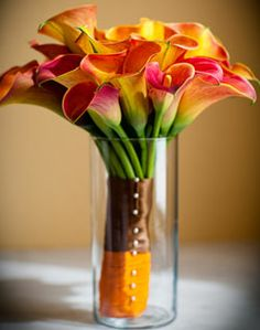 would be great for tables at reception with nothing wrapped around the stems and less yellow in the lilies