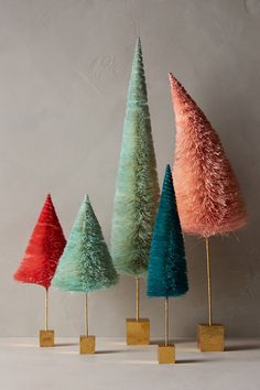 bottle brush trees from Anthropology! And check out how cute these are over on @cocokelley ! http://www.cocokelley.com/2014/12/whimsical-wonderland-christmas-table-setting/
