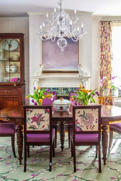 Color stimulates and works with all of the design elements in this dining room, designed by Susan Nelson Interiors. Love this beautiful clear glass chandelier; chandeliers | home lighting