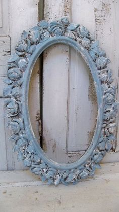Nice oval rose mirror, painted in slate blue