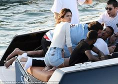 Hanging with the boat boys: Kendall was all smiles as she and her friends enjoyed a fun-filled afternoon on the luxury boat