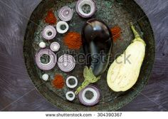 Oval plate with eggplants and onion rings - stock photo