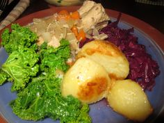 The Culinary Explorers: Coq Au Vin, roasted Atlantic potatoes, kale, and braised red cabbage with local pear and raisins.