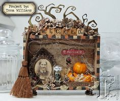 today's project is atreasure-trove of halloweencreativity created by emma williams. each devious detailtells a tale of artful odditiesthatsomething wicked this way comes...t!m supplies: inks:...