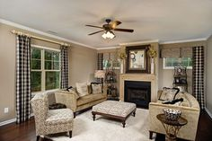 Black and white accents in a great room with a stunning mantel. The Barton plan built by Savvy Homes at Town Pointe. Jacksonville, NC.