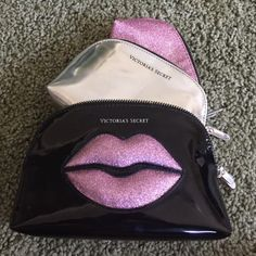 VS makeup bag set Set of 3 makeup bags. Only the black one was used. A few stains from makeup. The other two have never been used. Victoria's Secret Accessories