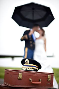 Kissing in the rain. SMP military #wedding  Photography: Robert and Kathleen - www.robertandkathleen.com Coordination: Jubilee Events - www.eventjubilee.com  View entire slideshow: Salute to Military Weddings on http://www.stylemepretty.com/collection/295/