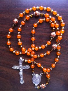 Sophie - Jade Orange Dyed Stone & White Opaque Glass Bronze Beads w/ Sterling Silver Crucifix & Center