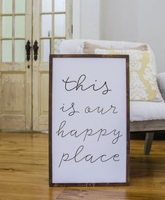 """This is our happy place"" Approximately 17"" x 25"" Printed Board + Stained Wood Frame Please note these boards are lightweight (2-5 pounds) making decorating and rearranging a breeze! Hangers are inclu"