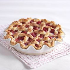 The sweetness of strawberries & raspberries makes a perfect filling for this lattice-topped pie. The bright red color of berries peeks t