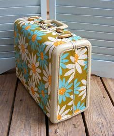 Modpodged vintage suitcase. I need to find some old suitcases & do this. I would make them match my decor &  keep current crochet projects in them. Everything for one project in a case, easily portable, I could just close the lid when not working on the item & it would look good sitting out. Also, the cats wouldn't get into the yarn!!!