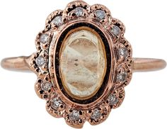 Ring in 14k rose gold with a 0.82 ct. yellow tourmaline and 0.13 ct. t.w. diamonds; $1,375; Jacquie Aiche