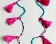 Tassels & bead twin Long Black necklaces/Trending jewellery/Boho necklace/seed bead long necklace  Twin necklaces in one deal! You can have two necklaces in one purchase. Wear it single or in pair, both looks very nice on any colour outfit. Necklace is made of tiny seed beads, stone beads and a lot of tiny tassels.  Ideal for beachwear and beach parties.  Length of the necklace approx. Inner necklace - 28 Outer necklace - 36  Shipping : We also use Express delivery, please check for the…