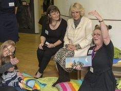 The Duchess watched some children as they had a story about an owl read to them.