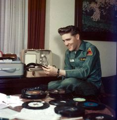 Elvis playing his records