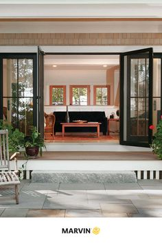 Contemporary living spaces with swinging patio doors allow for outdoor living when you want it and indoor living when you don't. Marvin Doors, Studio Shed, Modern Essentials, Wood Vinyl, Wood Interiors, Diy Patio, Patio Doors, Exterior Doors, Windows And Doors