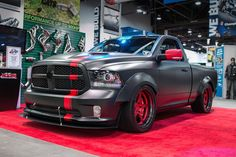 """Would you race this monster, in Gran Turismo? Congrats to our friends at Dallas Speed Shop on being named a 2016 GT Award finalist, with their """"Hellfire"""" Dodge Ram 1500, on display in the Kooks Headers booth, at the 2016 SEMA Show! It's powered by a 775HP supercharged 6.2L Hellcat V8 equipped with Kooks headers and exhaust and rides on 22x11.5 Forgeline FF3 wheels finished with Transparent Red centers & Black Pearl outers! See more at…"""