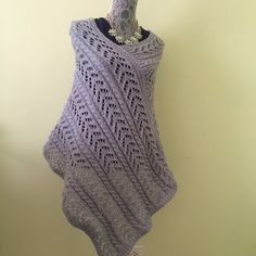 This grey soft texture is perfect for any season. It is knit from 100% wool. Cozy and comfortable .