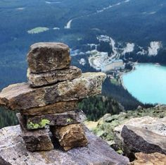 Mt St Piran, Alberta, Canada — by Kendal Zara. Every hike we made an inukshuk at the top, this has Lake Louise in the background #inukshuk #hiking #lakelouise...