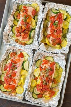 Salmon and Summer Veggies in Foil - Cooking Classy Preheat oven to 400 degrees. Cut 4 sheets of aluminum foil into lengths. Toss zucchini, squash, sliced shallot and garlic together with 1 Tbsp olive oil. Season with salt and pepper to taste and d Baked Salmon Recipes, Fish Recipes, Seafood Recipes, Low Carb Recipes, Dinner Recipes, Cooking Recipes, Healthy Recipes, Quick Recipes, Pasta Recipes