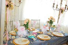 Victorian themed tea party setting - with a palette of dusty pink and powder blue, towering candelabra, gold plate chargers, and lace napkins