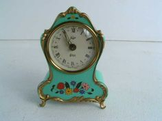 """Cute 5"""" vintage alarm clock made in Germany is marked Staiger with a Moulin Rouge swiss musical movement."""