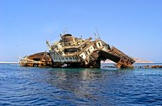 Shipwrecked American Star (formerly SS America) at Fuerteventura in the Canary Islands (photo from July 2, 2004 - as of March 2013, the remains of the wreck are only visible during low tide). Description from pinterest.com. I searched for this on bing.com/images