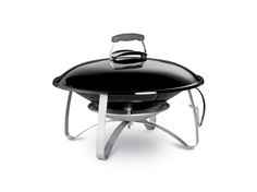 Just add marshmallows to the Weber Fireplace for the perfect summer camping evening