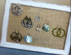 Painted frame ($2) + Burlap $(.25) attached to the back = Super easy/cheap earring holder!