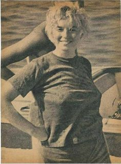 Rare, candid photo of a wind blown Marilyn Monroe on a boat.