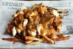 30 Yummy Vegetarian Takes On Classic Meat Dishes. Thanks to meat-free poutine and carrot hot dogs, your old favorites are back with a veggie vengeance. Vegetarian Poutine Potatoes and cheese are the two major food groups, anyway. Poutine Recipe, Canadian Dishes, Canadian Recipes, Making French Fries, Vegetarian Recipes, Cooking Recipes, Good Food, Yummy Food, Vegetarian