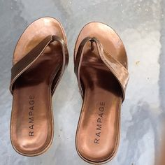 ‼️SALE‼️VERY CUTE THONG SLIDES  Bronze faux patent shoes.  Nice by the beach or swimming pool with your favorite summer outfit.  Nearly new.  Cork wedge is so up to the minute.  Makes  legs appear longer and sexier  RAMPAGE Shoes Sandals