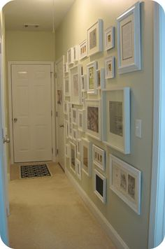 Photo Gallery Wall with all white frames in hallway (with tips on how-to)