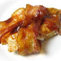 Barbeque Bacon Chicken Bake | Chicken is wrapped in bacon and baked with barbeque sauce in this simple recipe. You can make them on the grill, too.