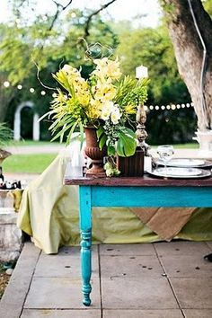 nice way to do an old table - stain the top and paint the legs  an eye-popping colour