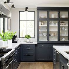 Absolutely love the mixture of styles in this kitchen design by @jeanne_rapone. What is your favorite detail? We adore furniture style glass front cabinets...so unique & beautiful! | Via Instagram: @scoutandnimble