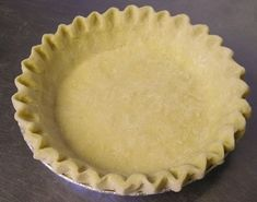 """Low Fat Pie Crust - for homemade pop tarts & pies :)  NO CHOLESTEROL - LOW FAT - PIE CRUST  1 1/3 c. flour 1/2 tsp. salt 1/3 c. oil (Puritan, Canola, etc.) 3 tbsp. skim milk Combine flour and salt in bowl. Blend oil and milk in bowl. Add to flour mixture. Stir with fork until forms large clumps. Press into ball. Flatten to form 5-6 inch """"pancake"""". Roll between sheets of wax paper. Peel off top sheet. Flip into 9 inch pie pan. Remove other sheet. Press dough into pie plate. Trim and flute."""