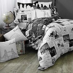 Perfect for a traveler, the Passport Comforter Set features clippings of the worlds most beautiful cities London and Paris in soft script and bold typeface in black and grey on a crisp white ground. Reverses to the inverse color scheme on a black ground.