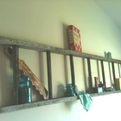 A ladder used as a little shelf to display some of my collection of antiques and family heirlooms.