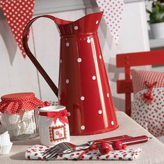I love red enamelware, and this is so pretty with the white polka dots!
