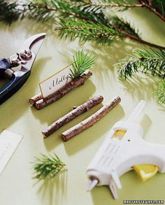 simple rustic Christmas place card holder made out of sticks and a bit of fresh greenery.