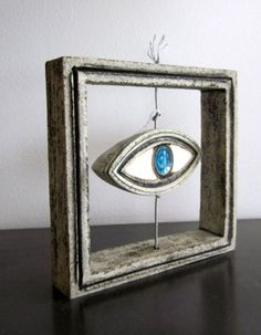 Ceramic decorative frame with evil eye sculpture blue and grey art
