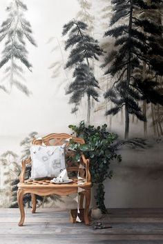 De Gournay's 'Abstract Pines' hand-painted silk wall covering instantly transports to a misty Scandinavian forest.