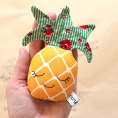 Hello, my name is Miranda. Im a little topical Pineapple Rattle and I like to shake, shake, shake, to music and dance all around. I am made from quality cotton and my little face is hand embroidered. I contain a safety rattle. Made from a Ribryba original pattern they are perfect for a baby shower or new baby gift. Pattern on material may vary slightly from rattle to rattle  13cm tall, I am just the right size for baby to hold. Perfect for the car or pram.  All my handmade items are made…