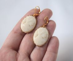 These beautiful vintage glass cameos are so lovely. Soft and sweet, they are perfect for a pair of romantic, feminine earrings! They are a high-quality glass in a warm ivory color. Very limited stock!