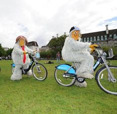 The Wombles taking a spin on a Barclays Cycle Hire bike.