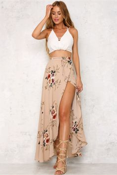The Ivy Cottage Maxi Skirt is long and flowy, with a gorgeous floral print, a self tie and a half inner lining. Style with an off shoulder crop top and a necklace!  Maxi skirt. Half lined. Cold hand wash only. Model is standard XS and is wearing XS. True to size. Slightly stretchy fabric.  Cotton/polyester.