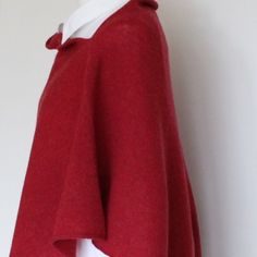 Thinking of cosy Christmas morning wrapped up in soft merino lambswool berry red poncho to open the presents with family. Lovely gift to give or get.