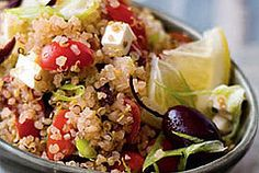 Greek-Style Quinoa Salad (skip feta for ETL or vegan) 1 cup quinoa 2 cups water 3 tbsp. olive oil ¾ cup fresh lemon juice 1 tsp. dried oregano 1 clove garlic, minced or pressed in a garlic press ¼ cup kalamata olives 1 bunch scallions, chopped 1 pint grape tomatoes, halved 7 ounces sheep's milk feta cheese, cubed ¼ cup diced red onion Salt and pepper to taste