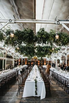 modern warehouse wedding with hanging greenery